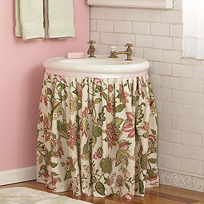 If you have a pedestal sink, add a skirt and store cleaning supplies underneath.
