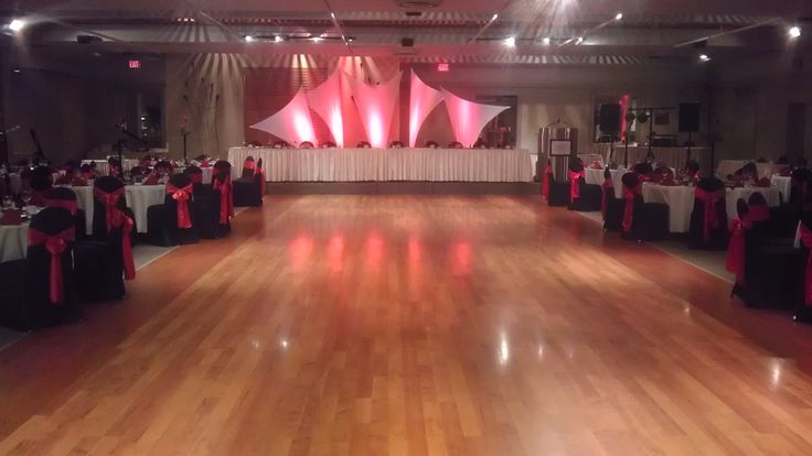 Red and Black Wedding with striking backdrop by Qdesign