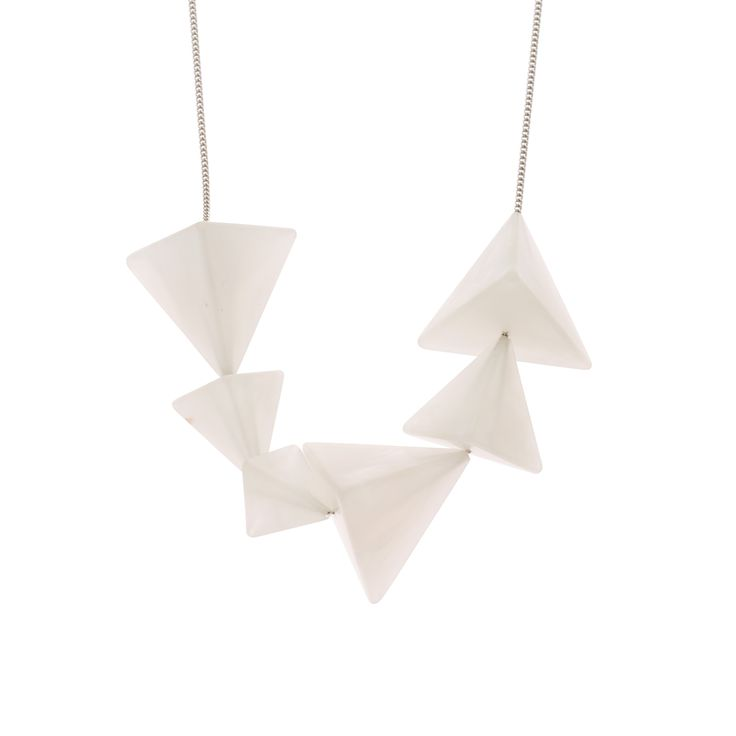 Featuring a row of 3D marble pyramid shapes on a silver chain, this Luxe Necklace adds a contemporary edge to your Christmas party outfit.