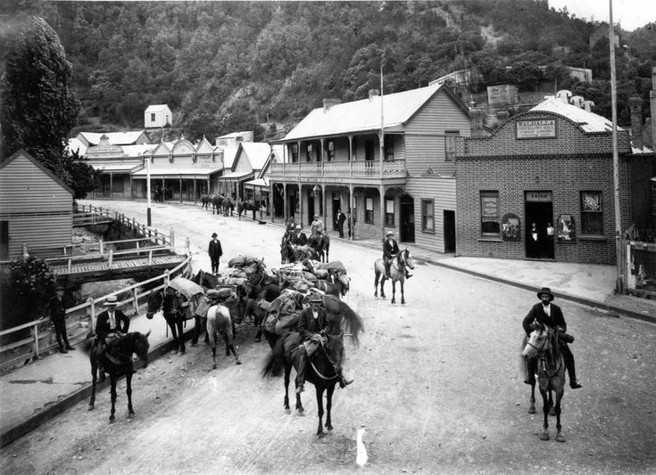 Geological Survey party leaving Walhalla for Mount Baw BawVictoria Australia , January 1904. On horseback at left is William Baragwanath, who published detailed reports on the Ballarat and Walhalla goldfields and would become Director of the Geological Survey in 1920.