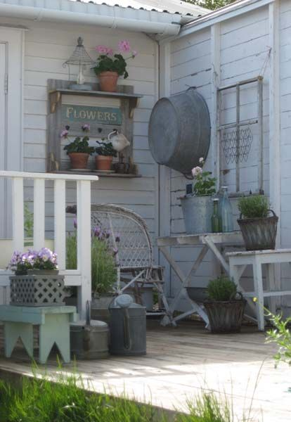 Vintage aluminum surrounding flowers on a patio, such a great idea.  If you have things you love but can't find places for them inside, try putting them out in the garden!