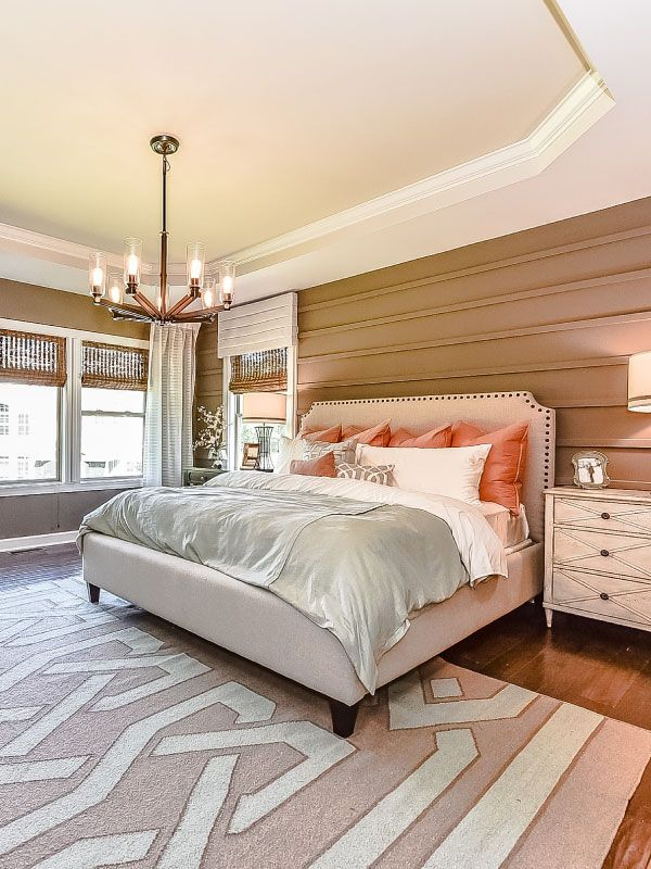 An Open And Bright Master Bedroom With Touches Of Rust Orange Tan