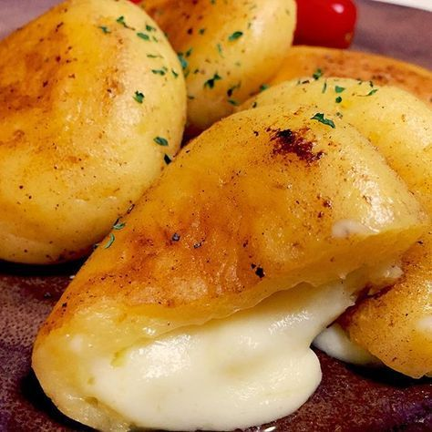 Fried dumplings with cheese filling