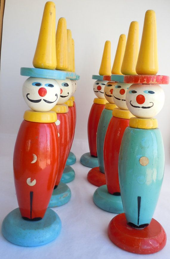 Bright colors and cheer: loving these vintage wooden clown toys.