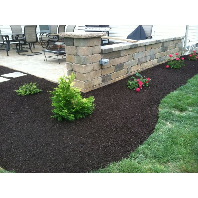 Great Landscape Design Install Around A Patio Retaining Wall.