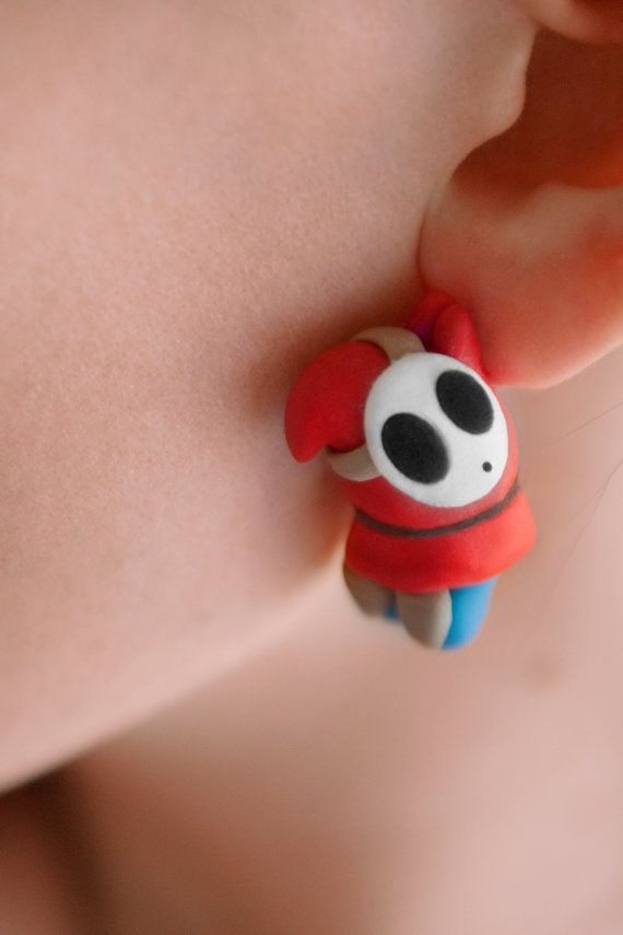 Super awesome accessory for any Mario fan! This Shy Guy earring set made of polymer clay is a perfect example of the clumsy villain we all remember!