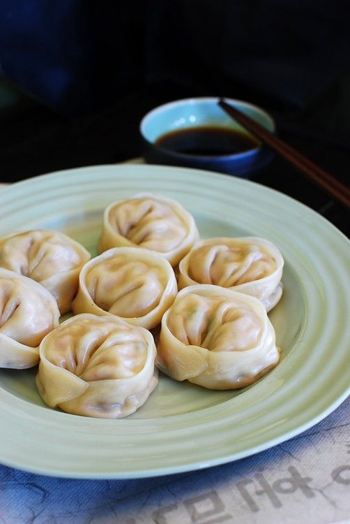 Mandu (Korean dumplings)- it's a tradition to gather around the table to make the dumplings in preparation of the New Year's feast. #korean