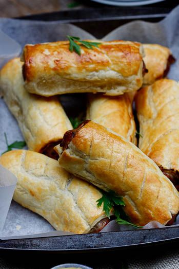 Pork sausage rolls with truffle mustard in puff pastry.
