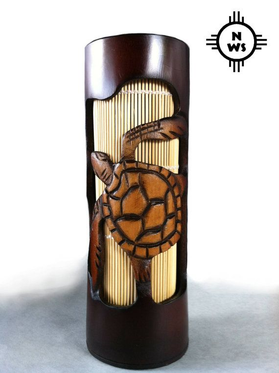 Solid Bamboo Tiki Lamp made by hand. Each lamp is a unique piece of art. Bamboo shade insert for back lighting. approximately 10 tall and 4 wide. 110v 3ft cord with switch and 15 watt bulb. Beautiful hand carved Sea Turtle.