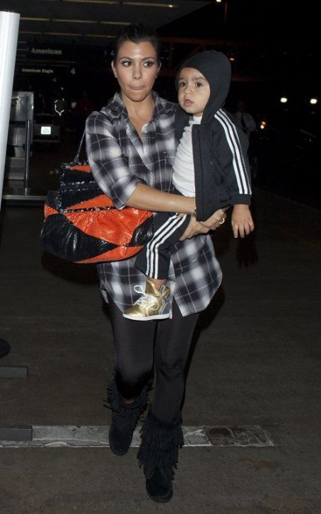 Never staying in one place for too long, Kim Kardashian and her sister Kourtney were spotted arriving for an outbound flight at LAX Airport in Los Angeles on Monday night (September 19).