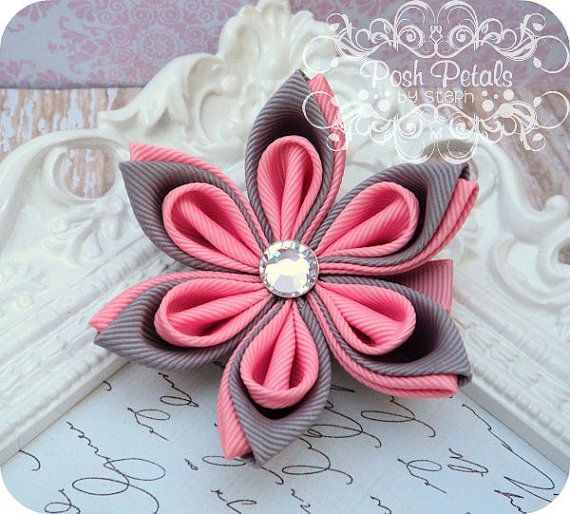 Folded flower. {I pinned the origami for paper flowers with this look . . . wonder if fabric can be folded too? I'll try!}