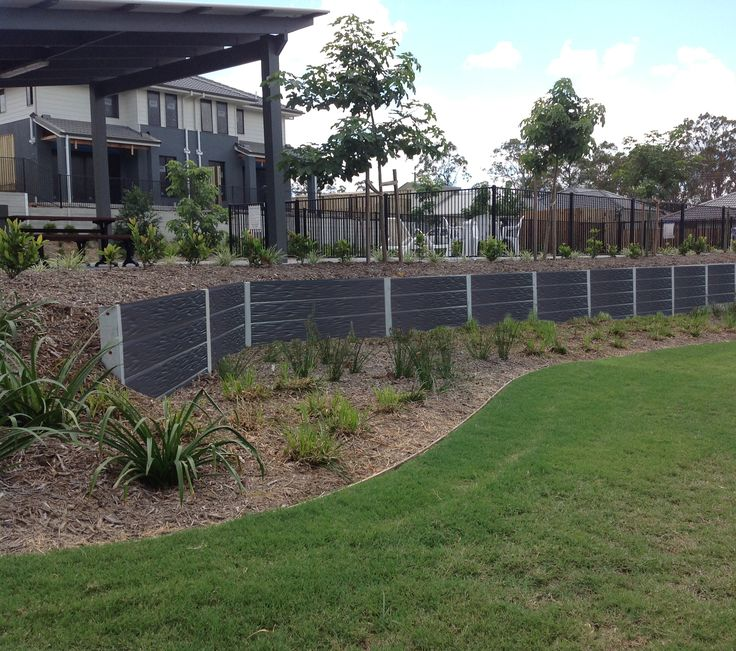 RIDGI concrete sleeper retaining wall.Visit www.ridgi.com.au for more information or or your local Bunnings store