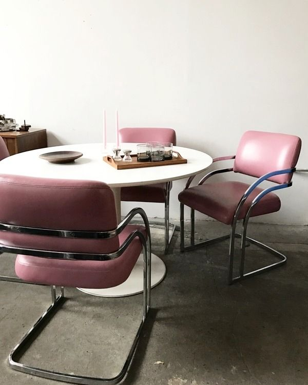 1970s chrome and pink leather Milo Baughman chairs. Great curved legs that wrap around the back of the seat.; everything's In perfect vintage condition.
