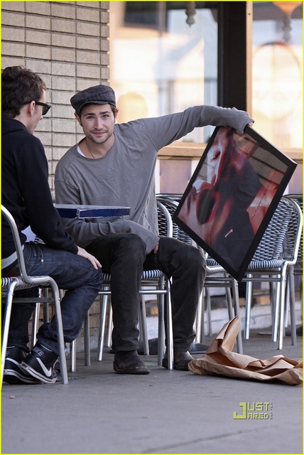 omg the picture he's holding.Photos, Holding, Pictures