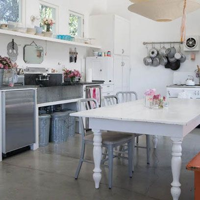 Love this kitchen - the beautiful white table and industrial steel look.