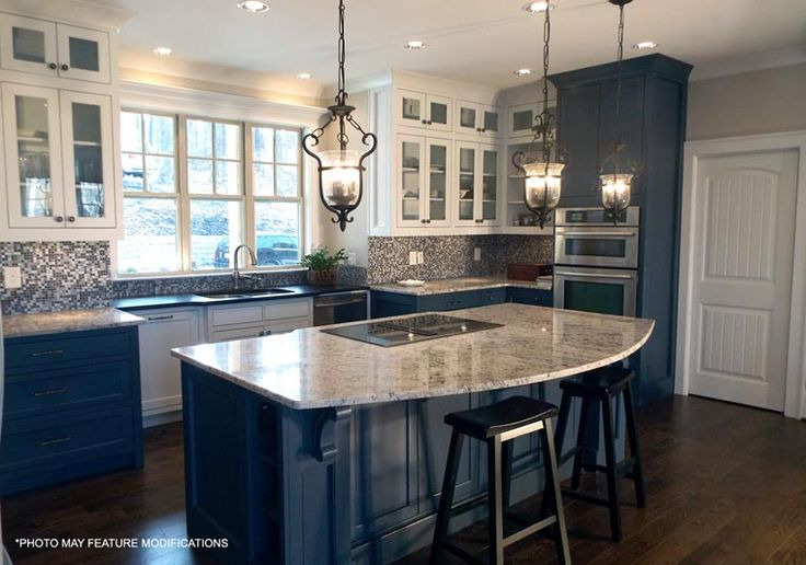 I love this floor plan and I love this kitchen with the dark and white cabinets! Back splash is a little to busy for me.