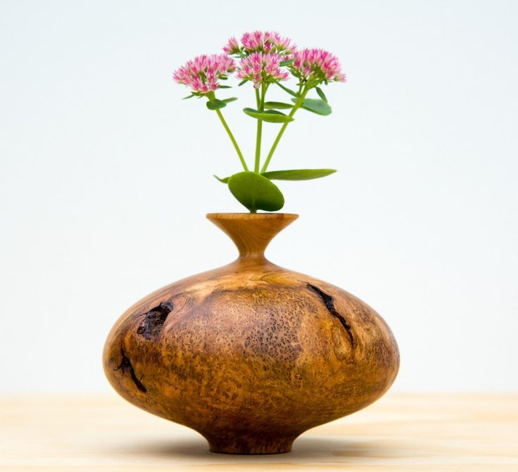 """Each unique twig pot is hand turned on a lathe from cherry burl. We utilize simple modern forms to emphasize the woods natural characteristics. A Danish oil finish enhances the woods beauty. 3.5"""" Tall"""