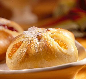 Authentic European bohemian-style kolaches (koh-LAH-chee), unlike the open filled versions found in most of the U.S., have sweet dough wrapped around the fruit filling. In this recipe,   canned fruit pie filling makes the treat easy to assemble.