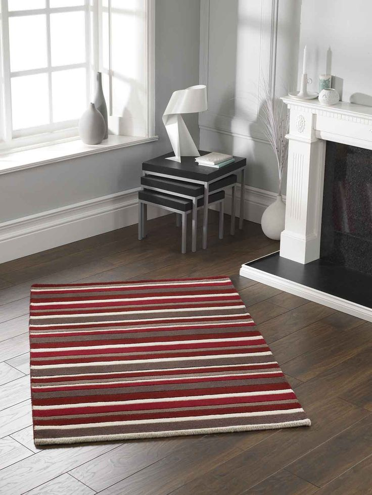 Striped Rug_ A beautiful and modern way to decorate your floor instantly. #stripedrugs #redrugs #purewoolrugs #largerugs #modernrugs