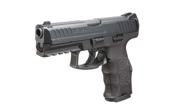 American Rifleman's Kelly Young checks out the striker-fired 9 mm Luger VP9 pistol from H&K.