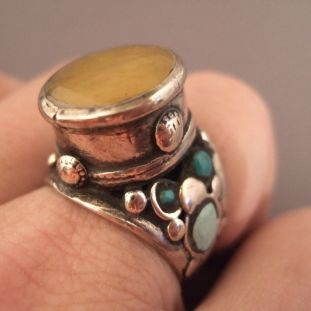 Silver, turquoises, amber, India Description This amber bead is exceptional and you can find also this type of design in Iran, in Afghanistan or in Turkmenistan... Size:11adaptable Weight:16,4gr
