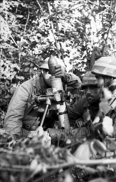 German fallschirmjäger operate a mortar in Normandy. 1944.