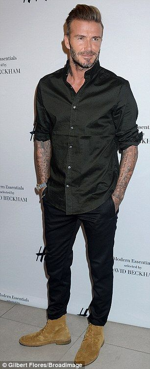 David Beckham looks dapper as he unveils new H&M range