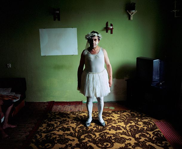Rafal Milach, Jozef Maksymiuk (59) posing for portrait in ballet dancer disguise in his house. For most of his 25-year career, he had been performing as a clown. He has been retired for 8 years.