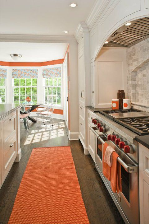 Shelter Interiors LLC - kitchens - white and orange kitchen, kitchen with orange accents, kitchen with pops of yellow, curved kitchen hood, ...