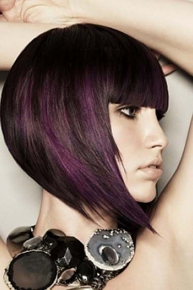 Streaks of dark purple in brunette hair is perfect for fall! This bob shows off the dramatic color oh, so well