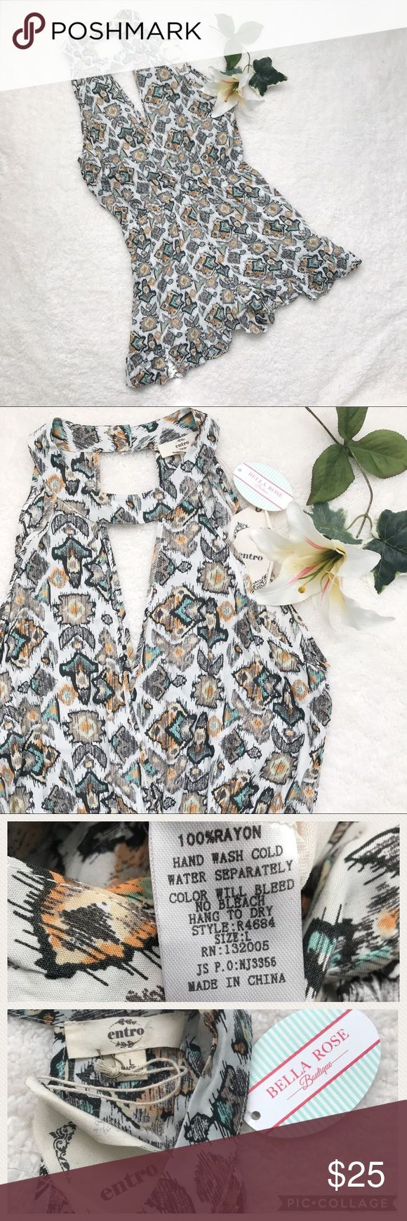 NWT ENTRO Romper Boutique Shorts Spring Festival This listing is for an adorable romper by entro, a brand sold at many boutiques. This one is from a local boutique called Bella Rose.   Romper has so many cute details. Double button closure behind neck. Light and flowy fabric. Asymmetrical short length. Elasticated waist.   Perfect for spring festivals and summertime!   Size large. No holes or stains.   Smoke free home. Please see pictures for measurements. Feel free to ask any questions or…