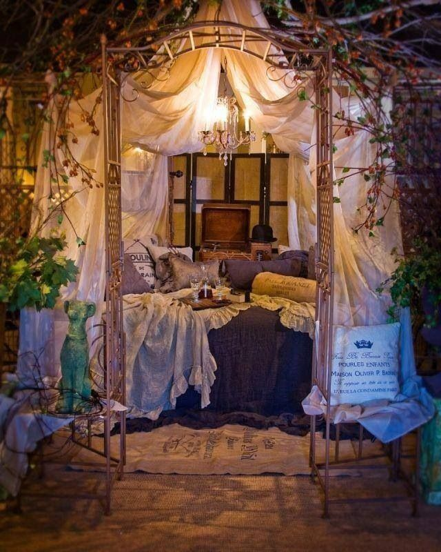 Whimsical bedroom .. Dreamy (all the curtains, door frame, vines hanging down, chandelier)