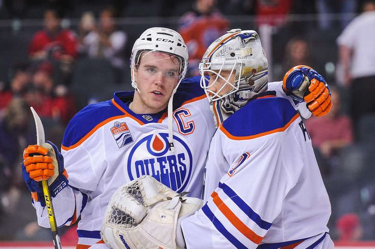 CALGARY, AB - JANUARY 21: Connor McDavid #97 (L) and Laurent Brossoit #1 of the Edmonton Oilers celebrate after defeating the Calgary Flames during an NHL game at Scotiabank Saddledome on January 21, 2017 in Calgary, Alberta, Canada. (Photo by Derek Leung/Getty Images)