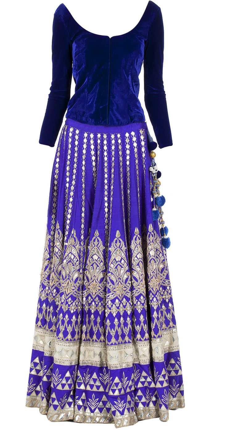 Blue embroidered lehenga with velvet bandi by ANITA DONGRE. www.perniaspopups...