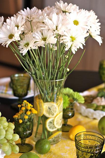 Sliced lemons in vase with flowers