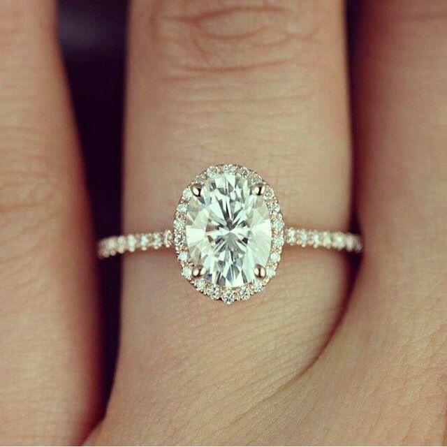 Petite oval engagement ring by Taj Jewels.