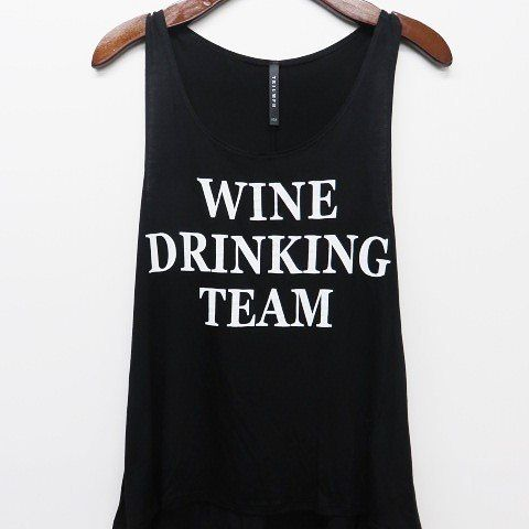 """Wine Drinking Team Graphic Tank (Black)  TO BUY: Comment with your email address and you'll receive a secure checkout link.  Options:  S(2/4): 22.00  M(6/8): 22.00  L(10/12): 22.00  A flowy graphic tank is for those casual days. This tank is not fitted and is more on the loser side. They do run true to size however If you want a more """"oversized"""" look we suggest sizing up! You can pair this Tank with your favorite jeans shorts or leggings for a super casual #OOTD! Material: 95% Rayon 5%…"""