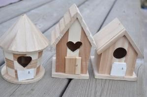 I decided to use dollar store bird houses for the fairy houses themselves. I wanted them to look more like fairy houses, so I sawed off the bird perch and replaced it with a fairy door, made out of a small sawed off piece of a paint stick. by lori