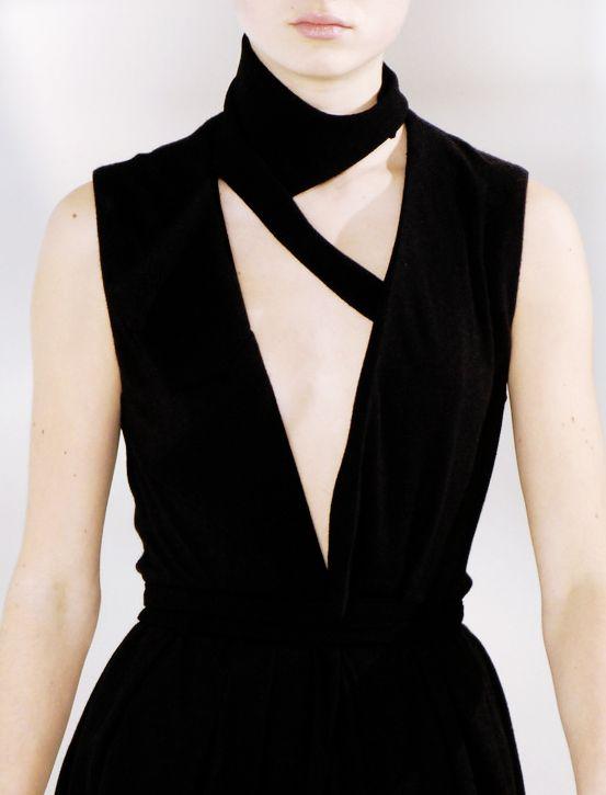 Black dress with triangle cutouts; bold geometric fashion details