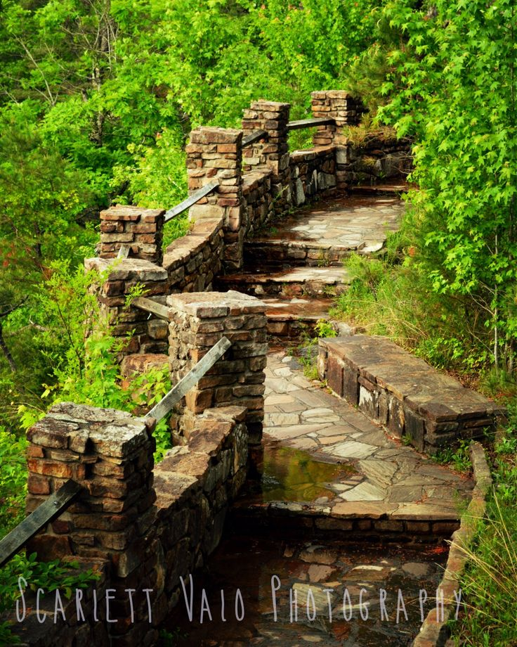 Stone passage at Petit Jean State Park in Arkansas, which gives a beautiful view of the falls.