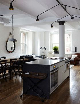 Clean and sleek with a hidden pantry, this urban kitchen offers graphic drama with high-contrast industrial-style finishes