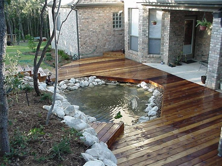 Outdoor Deck....I think i would like smaller water feature & more deck (& a waterfall into the water feature)