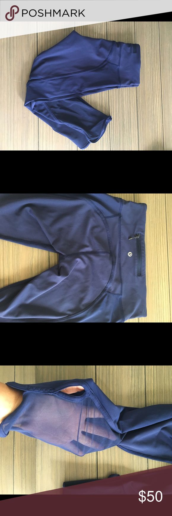 Royal blue lulu crop Mesh on black calves with a little slit on each leg down .. seams shown with little wear in picture, but good condition lululemon athletica Pants Leggings