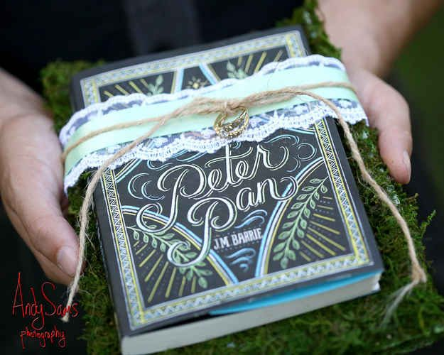 If you're afraid of losing them, you can tie them tightly to the cover of a book. | This Peter Pan Wedding Will Make You Feel Like A Kid Again
