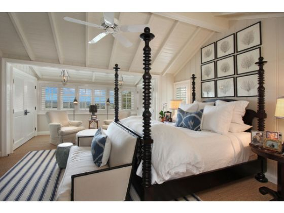 Orange County Register - 1930s Laguna Cottage - Master bedroom with vaulted wood beamed ceilings - love the sea fan art above bed