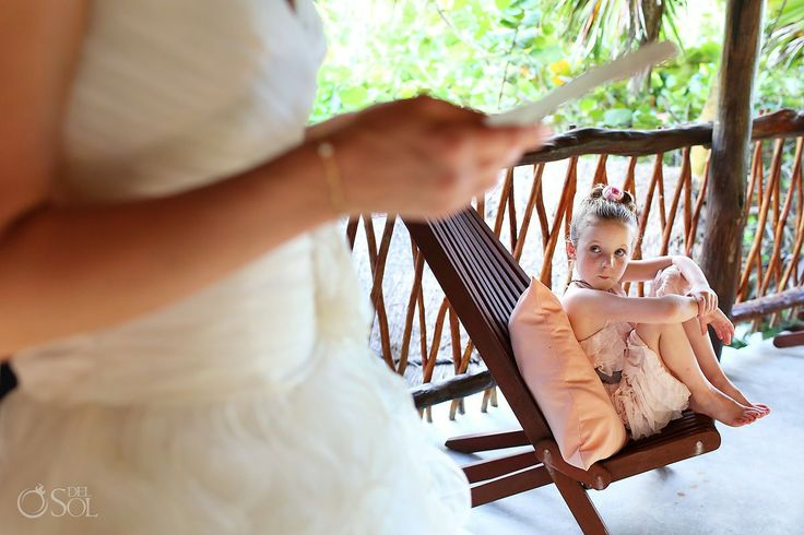 Darling flower girl takes it all in as they get ready for a destination wedding in Tulum, Riviera Maya at Nueva Vida de Ramiro boutique hotel. Mexico wedding photographers Del Sol Photography.