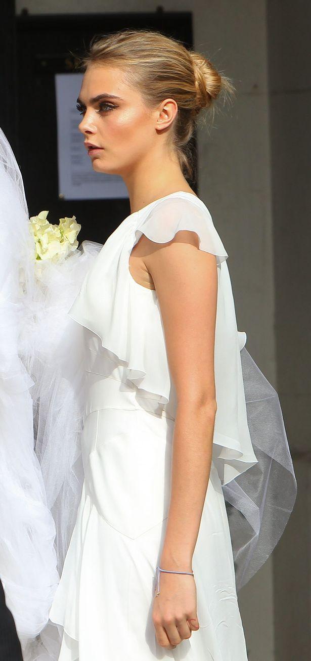 Poppy Delevingne's wedding. Cara in white Chanel dress