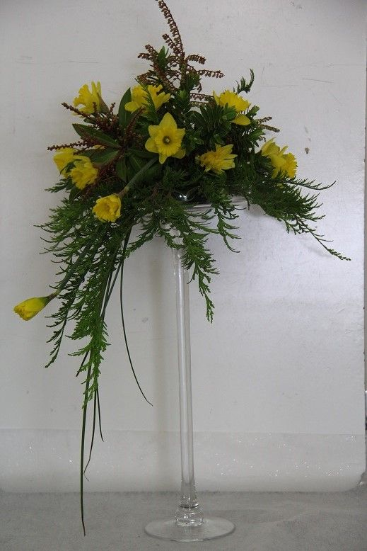 glass stand (any flower can be used) http://www.wanakaweddingflowers.co.nz/gallery/