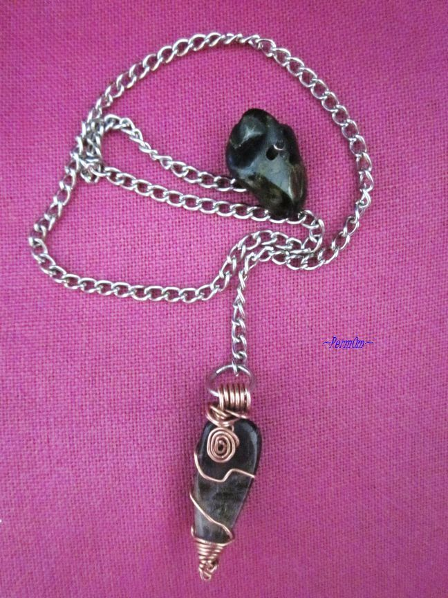 An amazing and powerful black smoky quartz pendulum with very beautiful copper work and chain with an amazing epidote/garnet to the finish that centers one during healing, and can provide a grounded link between the physical and higher selves, helping to uncover subconscious wisdom. Using this smoky quartz pendulum while you ask questions or during channeling enables you to reach higher states of consciousness.