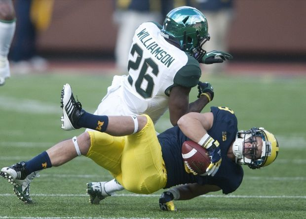 Michigan State's R.J. Williamson got the better of this collision, but Michigan won the war last season, scoring a 12-10 victory in Ann Arbor to snap a four-game losing streak against the Spartans.